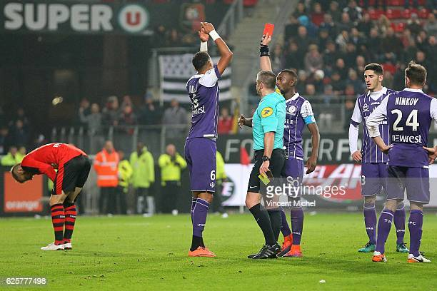 Christopher Jullien of Toulouse is sent off by referee Fredy Fautrel during the French Ligue 1 match between Rennes and Toulouse at Roazhon Park on...
