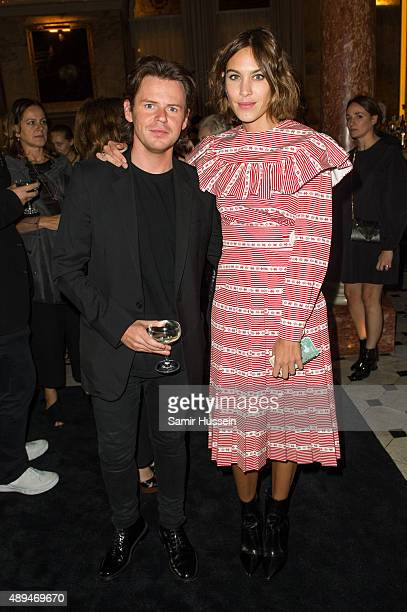 Christopher Kane and Alexa Chung attend the Business Of Fashion 500 Gala Dinner during London Fashion Week Spring/Summer 2016 on September 21 2015 in...