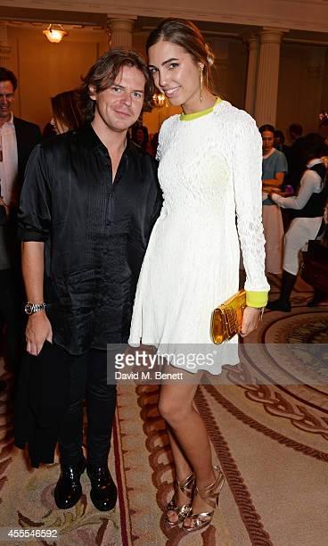 Christopher Kane and Amber Le Bon attend as Ambassador Barzun Mrs Brooke Barzun and Alexandra Shulman celebrate London Fashion Week at Winfield House...