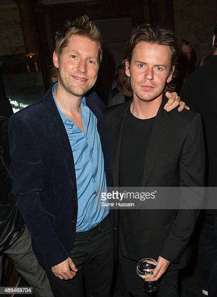 Christopher Kane and Christopher Bailey attend the Business Of Fashion 500 Gala Dinner during London Fashion Week Spring/Summer 2016 on September 21,...