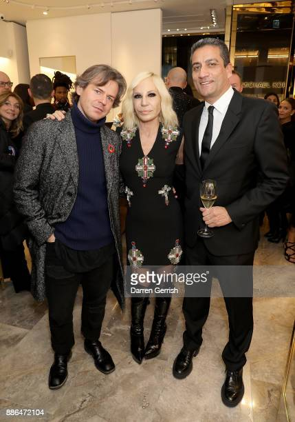 Christopher Kane Donatella Versace and Jonathan Akeroyd attend the Versace Boutique Opening on Sloane Street on December 5 2017 in London England