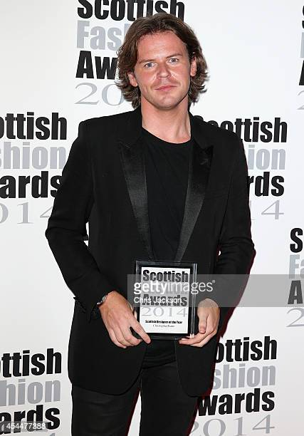 Christopher Kane poses with the Scottish Designer of the Year Award as she attends The Scottish Fashion Awards on September 1 2014 in London England