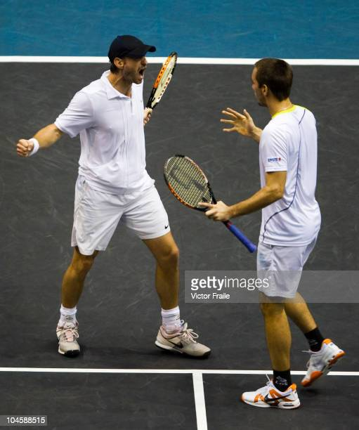 Christopher Kas of Germany and Viktor Troicki of Serbia celebrate match point during their doubles match against Jonathan Erlich of Israel and Jurgen...
