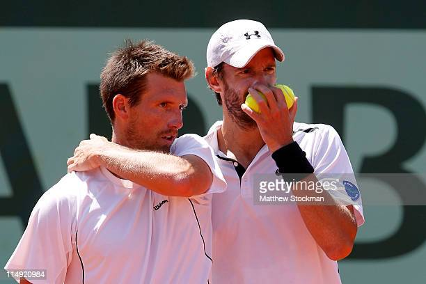 Christopher Kas of Germany talks tactics with his team mate Alexander Peya of Austria during the men's doubles round three match between Christopher...