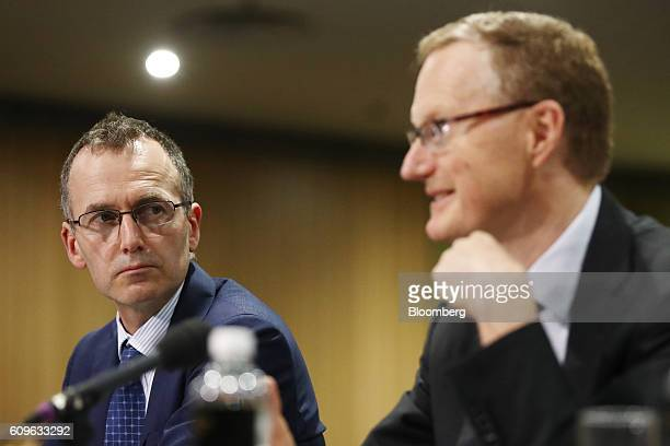 Christopher Kent assistant governor of the Reserve Bank of Australia left looks on as Philip Lowe governor speaks during a hearing before the House...