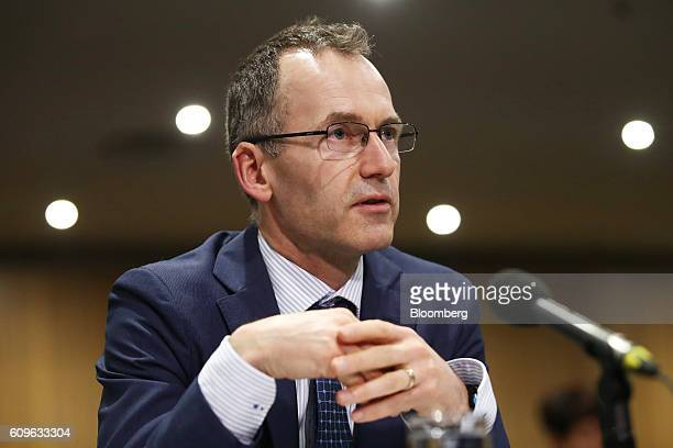 Christopher Kent assistant governor of the Reserve Bank of Australia speaks during a hearing before the House of Representatives economics committee...