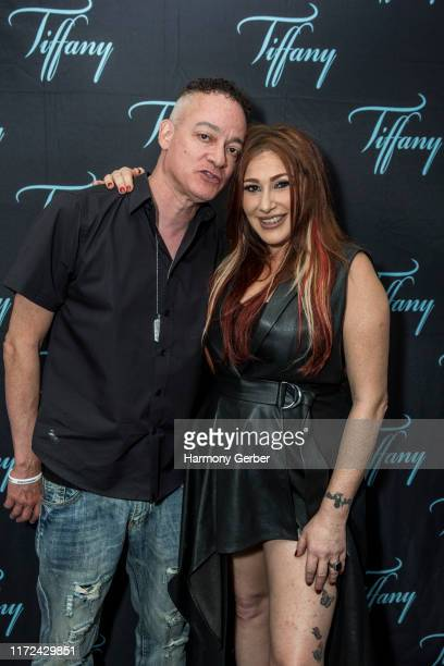 Christopher Kid Reid and Tiffany pose for a portrait backstage at the Whisky A Go Go on September 04 2019 in West Hollywood California