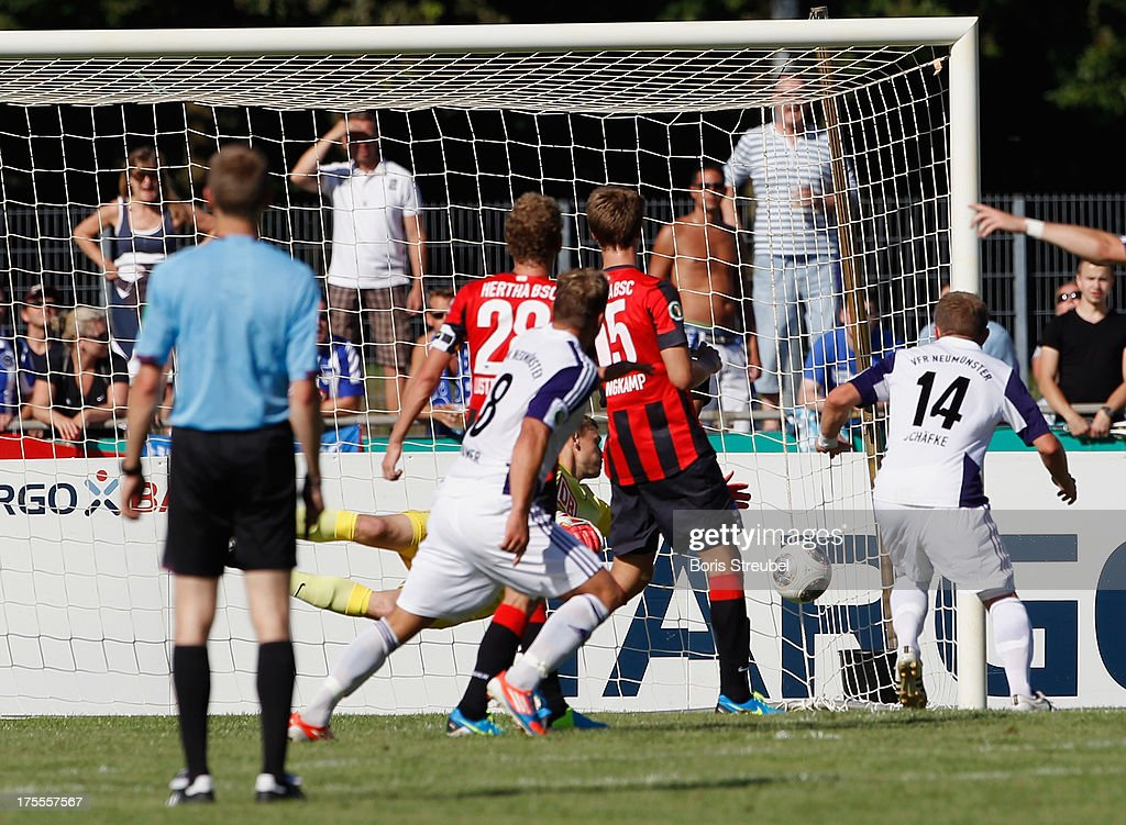 Christopher Kramer (2ndL) of Neumuenster scores his team's second goal during the DFB Cup first round match between VfR Neumuenster and Hertha BSC Berlin at Gruemmi-Arena on August 4, 2013 in Neumuenster, Germany.