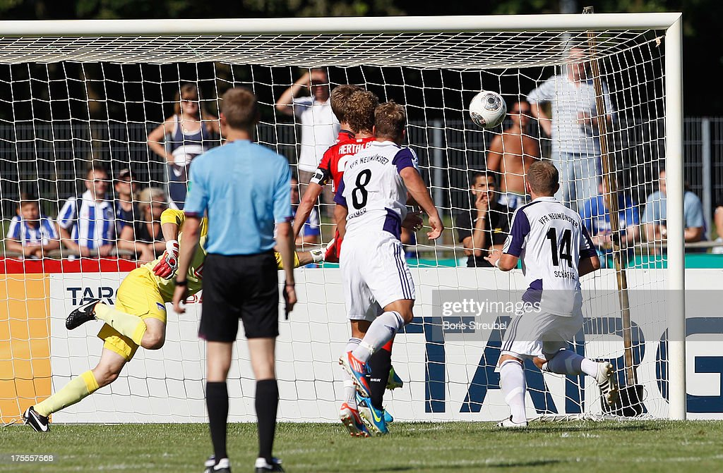 Christopher Kramer (C) of Neumuenster scores his team's second goal during the DFB Cup first round match between VfR Neumuenster and Hertha BSC Berlin at Gruemmi-Arena on August 4, 2013 in Neumuenster, Germany.