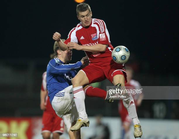 Christopher Lamprecht of Kiel and Tobias Schweinsteiger of Unterhaching compete for the ball during the 3 Liga match between Holstein Kiel v SpVgg...