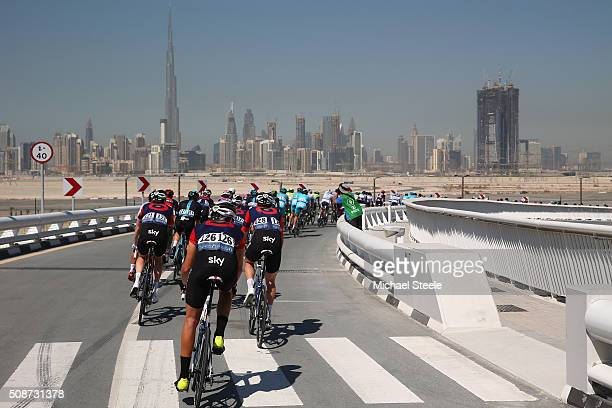 Christopher Latham of Great Britain and Team Wiggins brings up the rear of the peloton against the Burj Khalifa skyline during the Business Bay Stage...