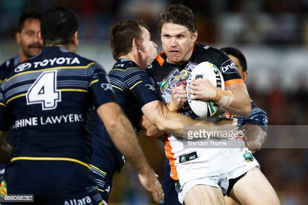 Christopher Lawrence of the Tigers is tackled by the Cowboys defence during the round six NRL match between the North Queensland Cowboys and the...