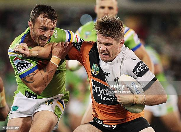 Christopher Lawrence of the Tigers is tackled during the round eight NRL match between the Canberra Raiders and the Wests Tigers at GIO Stadium on...