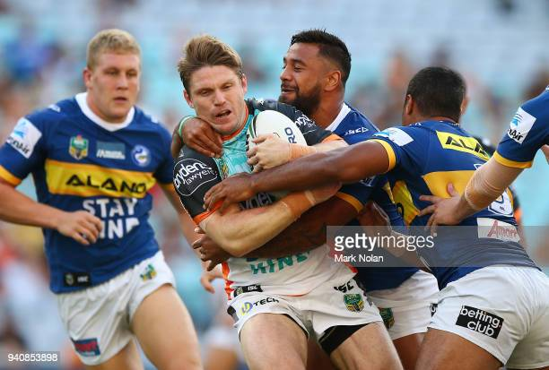 Christopher Lawrence of the Tigers is tackled during the round four NRL match between the Wests Tigers and the Parramatta Eels at ANZ Stadium on...
