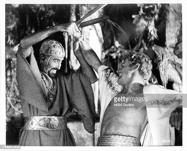 Christopher Lee and John Richardson wrestling for swords in a scene from the film 'She' 1965