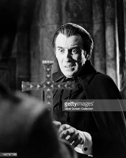 Christopher Lee British actor looking in fear at a crucifix in an image issued as publicity for the film 'Taste the Blood of Dracula' 1970 The Hammer...