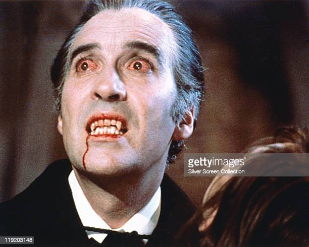 Christopher Lee British actor with bloodshot eyes and wearing pale facepaint and vampire's fangs in a publicity still issued for the flilm 'Dracula'...
