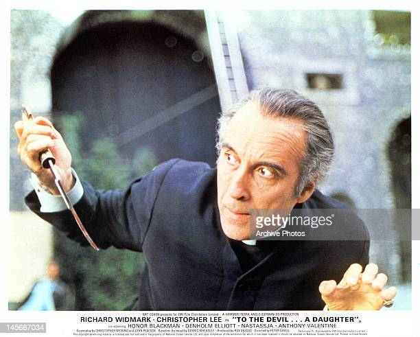 Christopher Lee holding bloody dagger in a scene from the film 'To The Devil A Daughter' 1976