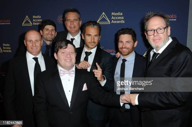 Christopher Lemole, guest, Zack Gottsagen, David Thies, Lije Sarki, Tim Zajaros and Albert Berger attend the 40th Annual Media Access Awards In...