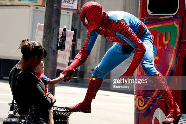 Christopher Loomis right wearing a SpiderMan costume greets a young fan and his mother who chose to remain unidentified on the Hollywood Walk of Fame...