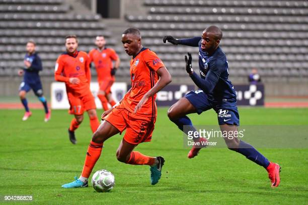 Christopher Martins Pereira of FBBP 01 and Cyril Mandouki of Paris FC during the Ligue 2 match between Paris FC and Bourg en Bresse at Stade Charlety...