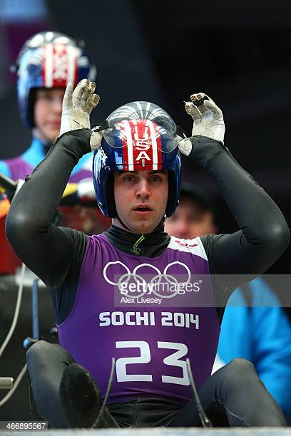 Christopher Mazdzer of the United States gets prepared during a men's luge training session ahead of the Sochi 2014 Winter Olympics at the Sanki...