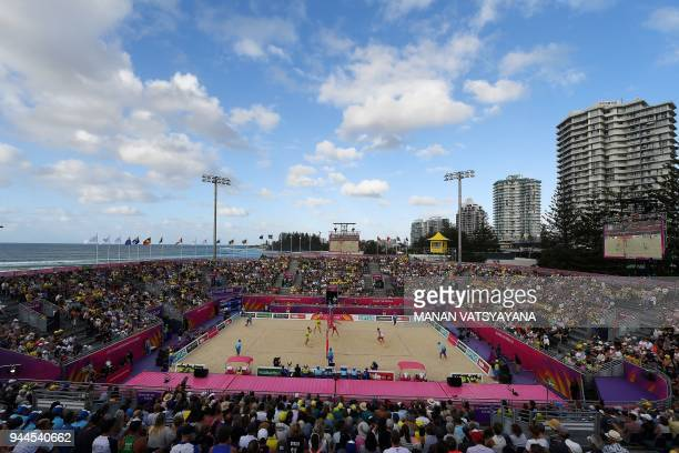 Christopher McHugh and Damien Schumman of Australia compete against England's Chris Gregory and Jake Sheaf during their men's beach volleyball...