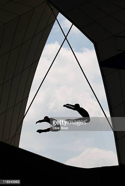 Christopher Mears and Nicholas Robinson Baker of Great Britain warm up during a training session prior to competing in the Men's 3m Springboard...