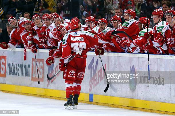 Christopher Minard of Koelner Haie celebrates the 32 victory after penalty shootout the DEL match between Koelner Haie and Krefeld Pinguine at...