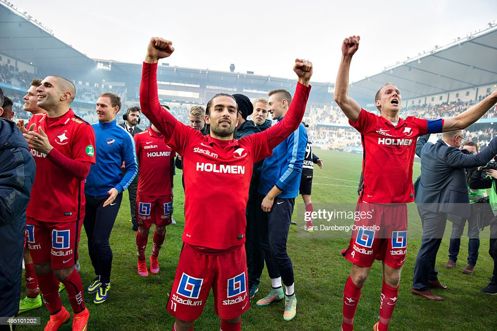 Christopher Nilsson Telo and Andreas Johansson and the team is celebrating the gold after the match between Malmo FF and IFK Norrkoping at Swedbank Stadion on October 31, 2015 in Malmo, Sweden.