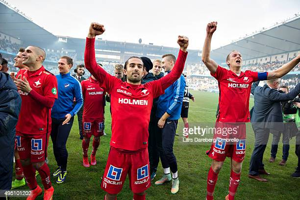 Christopher Nilsson Telo and Andreas Johansson and the team is celebrating the gold after the match between Malmo FF and IFK Norrkoping at Swedbank...