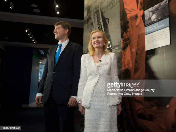 Christopher Nixon Cox grandson of President Richard Nixon and his mother Tricia Nixon Cox greet the media during the opening of The New Nixon Library...