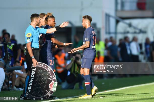 Christopher Nkunku and Neymar of Paris during the Ligue 1 match between Nimes and Paris Saint Germain on September 1 2018 in Nimes France