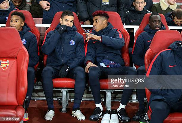 Christopher Nkunku Hatem Ben Arfa Presnel Kimpembe JeanKevin Augustin of PSG seat on the bench during the UEFA Champions League match between Arsenal...