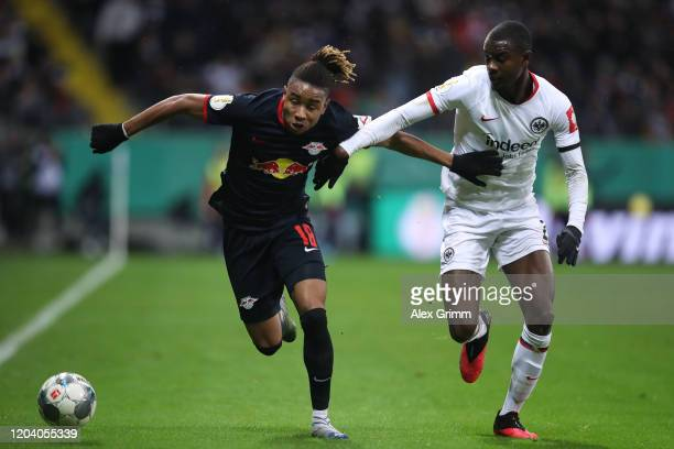 Christopher Nkunku of Leipzig is challenged by Evan N'Dicka of Frankfurt during the DFB Cup round of sixteen match between Eintracht Frankfurt and RB...