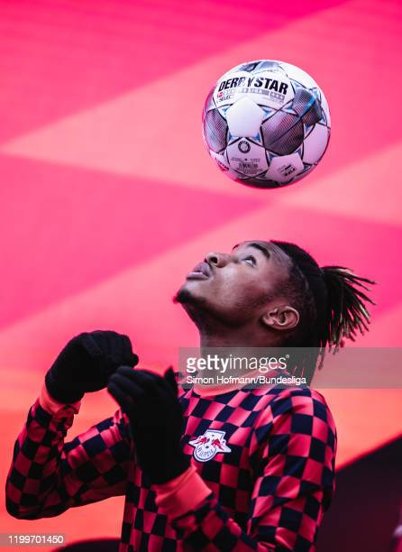 Christopher Nkunku of Leipzig looks on in the tunnel during the Bundesliga match between FC Bayern Muenchen and RB Leipzig at Allianz Arena on...