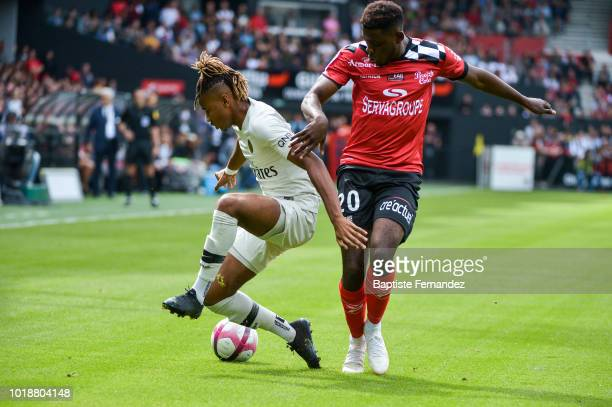 Christopher Nkunku of Paris Saint Germain and Felix Junior Gustave Eboa Eboa of Guingamp during the French Ligue 1 match between EA Guingamp and...