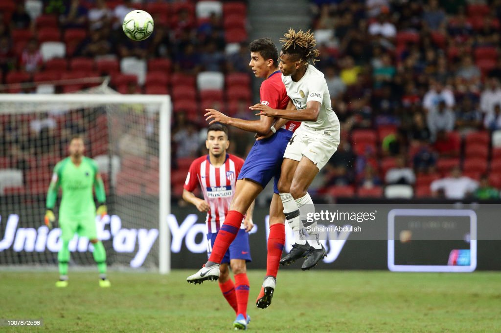 Christopher Nkunku of Paris Saint Germain and Rodri of Atletico Madrid jump for the ball during the International Champions Cup 2018 match between Atletico Madrid and Paris Saint Germain at the National Stadium on July 30, 2018 in Singapore.