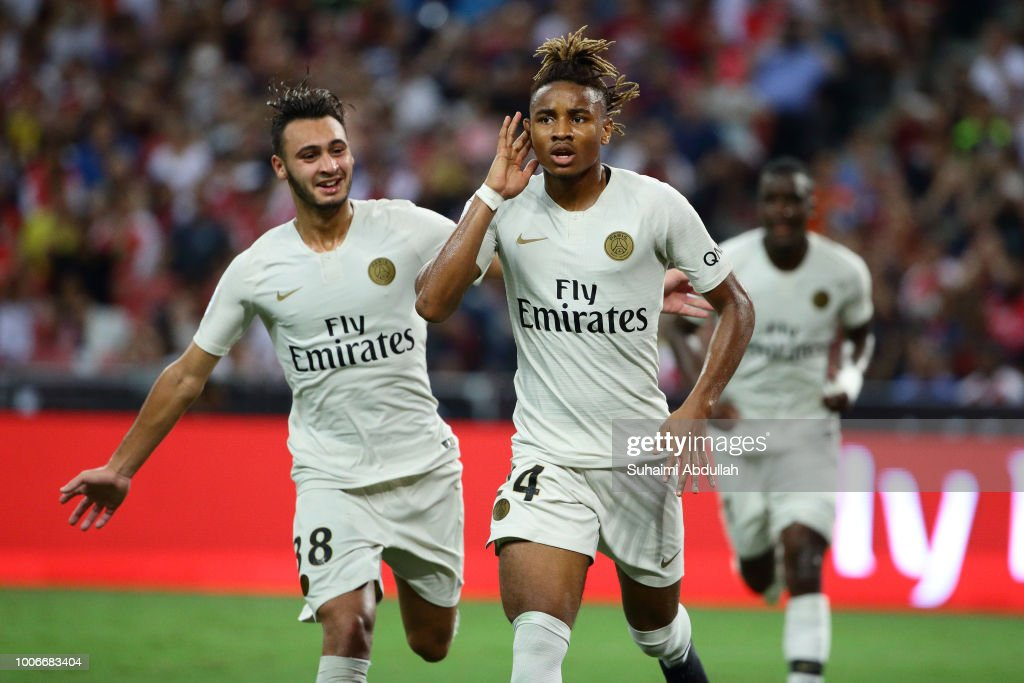 Christopher Nkunku of Paris Saint Germain reacts after scoring a goal during the International Champions Cup match between Arsenal and Paris Saint Germain at the National Stadium on July 28, 2018 in Singapore.