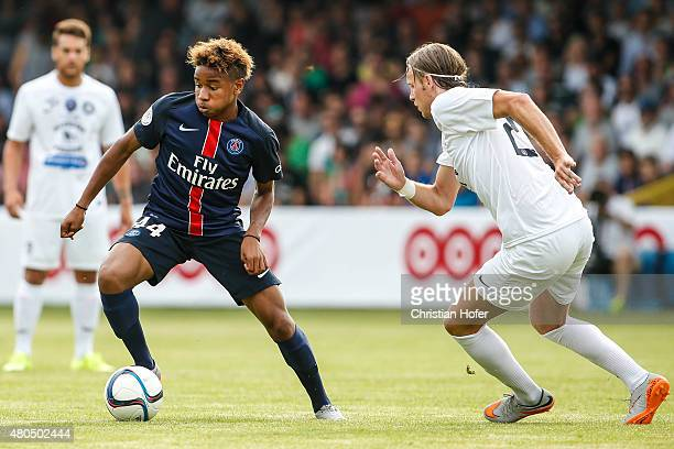 Christopher Nkunku of Paris Saint-Germain competes for the ball with Juergen Csandl of Wiener Sportklub during the Friendly Match between Wiener...