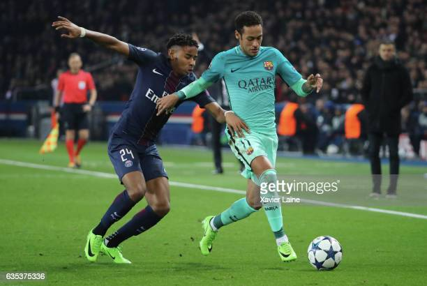Christopher Nkunku of Paris SaintGermain in action with Neymar of Barcelona FC during the UEFA Champions League Round of 16 first leg match between...