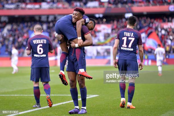 Christopher Nkunku of Paris SaintGermain is congratulated by teammate Presnel Kimpembe after scoring during the Ligue 1 match between Paris Saint...