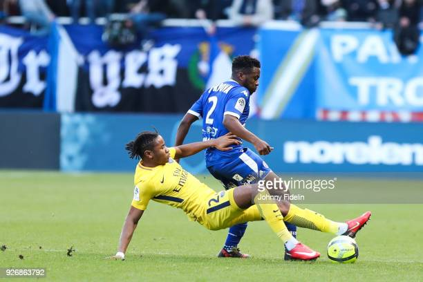 Christopher Nkunku of PSG and Jeremy Cordoval of Troyes during the Ligue 1 match between Troyes AC and Paris Saint Germain at Stade de l'Aube on...