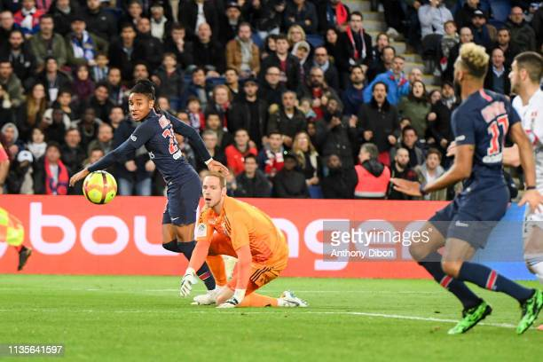 Christopher Nkunku of PSG and Matz Sels of Strasbourg during the Ligue 1 match between Paris Saint Germain and Strasbourg at Parc des Princes on...