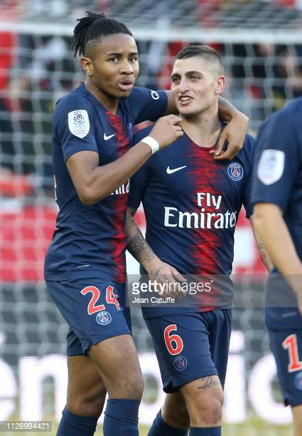 Christopher Nkunku of PSG celebrates his goal with Marco Verratti during the French Ligue 1 match between Paris Saint-Germain and Nimes Olympique at...