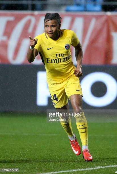 Christopher Nkunku of PSG celebrates scoring the second goal of his team during the Ligue 1 match between ESTAC Troyes and Paris Saint Germain at...