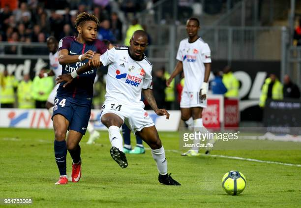 Christopher Nkunku of PSG, Gael Kakuta of Amiens during the Ligue 1 match between Amiens SC and Paris Saint Germain at Stade de la Licorne on May 4,...