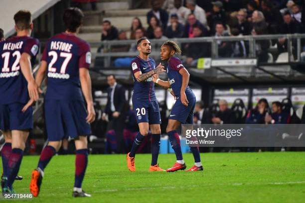 Christopher Nkunku of PSG is congratulated after putting his side 2-1 ahead during the Ligue 1 match between Amiens SC and Paris Saint Germain at...