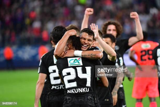 Christopher Nkunku of PSG is congratulated by captain Thiago Silva of PSG after putting his side 3-1 ahead during the French Cup Semi Final match...