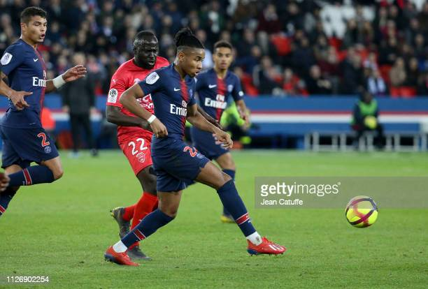 Christopher Nkunku of PSG, Sada Thioub of Nimes during the French Ligue 1 match between Paris Saint-Germain and Nimes Olympique at Parc des Princes...